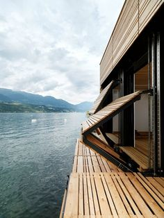 Folding wooden shutters on a house next to a lake