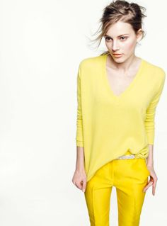 Yellow...the color of the season!  I also love the monochromatic dressing she has going on.