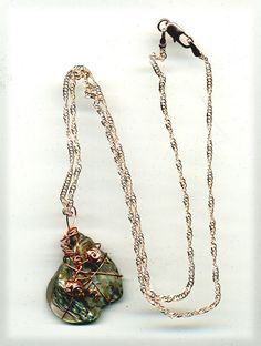 Handmade wire wrapped abalone pendant accented with copper color beads on chain. by CraftyClosetCreation on Etsy