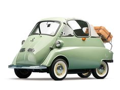 """1956 BMW Isetta 300 was one of the first cheap people's cars. Built in Brighton, with only a 300cc engine, the """"Bubble Car"""" has its only door at the front and opens with the steering wheel attached!"""
