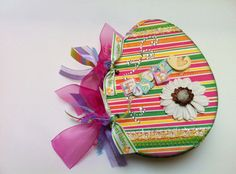 Cherish your Easter weekend meories in this cute chic egg shape chipboard album or gift grandma as a bragbook