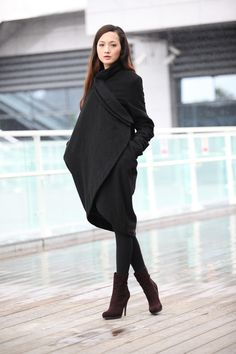 Black asymmetrical coat.