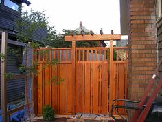 Love this craftsman style cedar fence - details and more pix on Portland Bungalow Renovation Blog http://bungalowrenovation.blogspot.com/2008/01/craftsman-style-cedar-fence.html