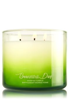 """Beautiful Day - 3-Wick Candle - Bath & Body Works - The Perfect 3-Wick Candle! Made using the highest concentration of fragrance oils, an exclusive blend of vegetable wax and wicks that won't burn out, our candles melt consistently & evenly, radiating enough fragrance to fill an entire room. Beautiful ombr�-colored glass adds a pop of fall color to your d�cor! Burns approximately 25 - 45 hours and measures 4"""" wide x 3 1/2"""" tall."""