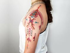 Brian Gomes bold red shoulder tribal tattoo