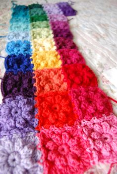 Scrappy rainbow-flower baby blanket. Great way to use up scraps of yarn - inspiration only.