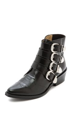 Black ankle boots are my favorite things on the planet to wear, and these have a Western flair that I just couldn't resist. Plus, the buckles jingle like spurs when I walk! Toga Pulla buckled ankle boots, $516, available at Shopbop.