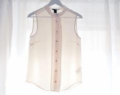 Silken see-thru blouse.