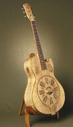 Wooden (maple and koa) art deco inspired resonator guitar by luthier Bob Rigaud.