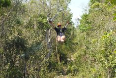 Cruising down one of the ziplines in the jungle of the Riviera Maya with Aventuras Mayas.
