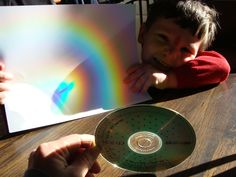 While looking into rainbow activities I found many examples of making a rainbow using water, a mirror, and a pie tin. They didn't seem very bright.   Here is what we got using the sunlight and a plain CD to reflect the light.  Very vivid rainbows!  enjoy!