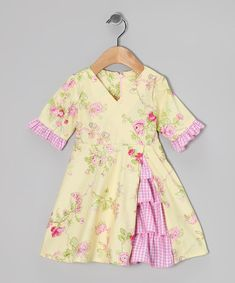 Move over, Scarlett O'Hara. Blending Southern belle style with modern flair, this fanciful frock shows off a fetching surplice bodice and a cascade of ruffles. Made of comfy cotton in a mix of fresh and frown-proof prints, it also has a zipper in back for easy changing.100% cottonMachine wash; tumble dryMade in the USA<...