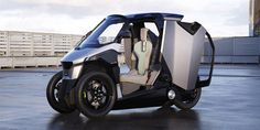 peugeot unveils an electric vehicle positioned between the two-wheel and four-wheel segments, equipped with a plug-in hybrid electric powertrain, two in-wheel motors and a combustion engine.