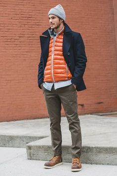 A smart casual combination of a navy pea coat and olive chinos can maintain its relevance in many different circumstances. Why not add brown leather work boots to the mix for a more relaxed feel?   Shop this look on Lookastic: https://lookastic.com/men/looks/pea-coat-gilet-long-sleeve-shirt/15876   — Grey Beanie  — Navy and White Gingham Long Sleeve Shirt  — Orange Gilet  — Navy Pea Coat  — Olive Chinos  — Brown Leather Work Boots