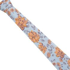 From the designer Jeff Banks, this blue tie has an embroidered orange floral design and comes in a regular blade on luxury silk.