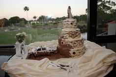 A Redneck Wedding Cake, complete with a 4 wheeler throwing mud at the cake http://celebrationsoftampabay.com/
