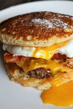 This pancake slider recipe is available at Invite Only in the Meatpacking District of NYC. The pancakes are infused with syrup to create a sweet bun to carry sunny side up eggs, American cheese, and bacon. This brunch recipe is no joke – it'll make you want to travel all the way to New York City for a breakfast sandwich. To wash it down, try their bourbon cocktail with fresh lemon juice and raspberries.#breakfastrecipes #brunchrecipes #travel #leisure #NYCfood #NYCeats Breakfast Burger, Breakfast Dishes, Best Breakfast, Breakfast Recipes, Sausage Breakfast, Breakfast Sandwiches, Pancake Breakfast, Breakfast Slider, Breakfast Ideas