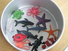 """Ice Excavating. My kids LOVE this. Freeze toys in a cake pan filled with water. Dump out on a towel in the back yard and let them chisel away with small tools to """"rescue"""" their animals/toys."""