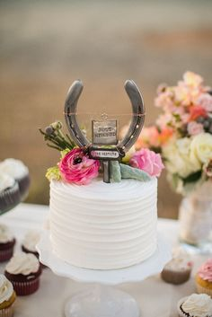 A horse shoe cake topper is in keeping with a wild west theme. Source: Kelly Boitano  #westerntheme #caketoppers #weddingcake