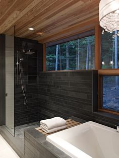 I like the shower, bath, color, and wood choice. Don't like the wide open window view though.