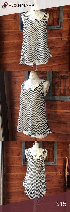 Liberty love sheer Chevron tank top size medium Liberty love sheer black and cream chevron tank top size medium/ NWT/ never worn and in excellent condition comes from a smoke free home and thanks for looking/ please use the offer button to make any offers and do not make offers in the comment section thank you❤️😃✌️❤️ Liberty love Tops Tank Tops