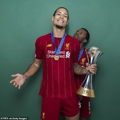 Liverpool stars show off FIFA Club World Cup title during photoshoot <br> Liverpool clinched their first-ever FIFA Club World Cup title on Saturday after Roberto Firmino scored an extra-time winner to earn a victory over Brazilian side Flamengo in Doha. Liverpool Stadium, Camisa Liverpool, Anfield Liverpool, Liverpool Champions League, Liverpool Players, Liverpool Fans, Liverpool Football Club, Fifa, Sport