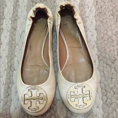 Tory Burch Cream Leather Reva Flats Tory Burch Reva cream leather classic flats. Classic logo plaque in chic cream leather at toes. Comfortable and stylish flat rubber sole with essentially flat heel. Scrunch back. Good used condition; some wear/discoloration/dirt around the logo, at leather sides, and on insides, but nothing that can't be cleaned up or that takes away from the style and look- the wear is not obvious. Soles in great condition. Extremely high quality. Harder to find Reva…