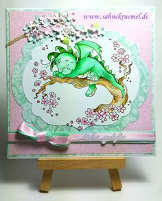 """Greeting Card with """"Dreamy Dragon"""" Whimsy Stamps; Designerpaper Dovecraft & """"Paper Flowers"""" First Edition; Ribbon American Crafts; Sentiment """"liebe Grüße"""" Iris-istible; Branch and flower die """"Garden Notes - Lilac"""" Elizabeth Craft Design; Colored with TwinklingsH2O"""