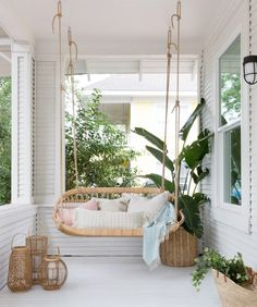 Swing into Summer: Porch Swings for Every StyleBECKI OWENS Style At Home, Wicker Porch Swing, Porch Swings, Wicker Porch Furniture, Decoration Bedroom, Relaxing Places, Swinging Chair, Outdoor Rooms, Outdoor Living