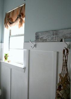 Beach Bathroom traditional bathroom. love the wall board and rustic sign.
