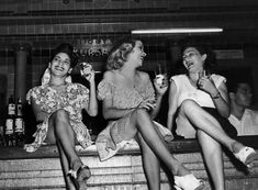 1950 Three women perched on the bar at the Cabaret Kursal nightclub in Havana. The Havana high life, before Castro and the Revolution