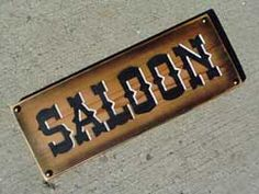 Saloon sign: 14 inches long and ready to hang. Put it with other home decor to give a feel of the Old West.
