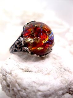 vintage Czech faux opal glass ring ( Etsy:: http://www.etsy.com/listing/108827342/chinese-dragon-abyss-opal-ring )