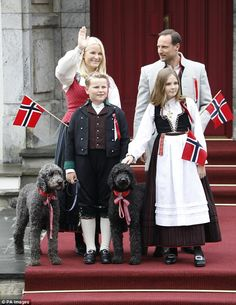 Prince Sverre Magnus and Princess Ingrid Alexandra take care of the family dogs as they joined their parents Crown Prince Haakon and Crown Princess Mette-Marit on Norway's National Day