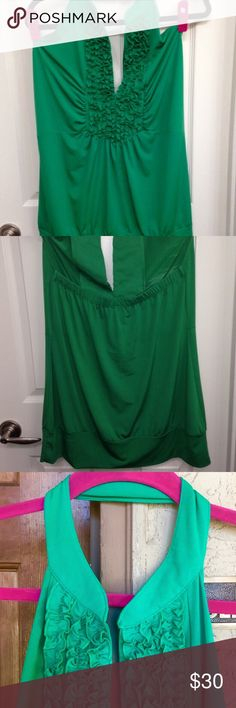 "🆕 Torrid Green Halter Top NWOT Fun kelly green ruffled tuxedo-style halter top by Torrid. Size 0 (XL) Measurements: Bust: 36"", Waist: 40"" & Length: 30"". Great stretch material 96% poly & 4% spandex. Never worn & no flaws. (Color is more accurate in 4th photo). 👍🏻15% off 3+ item bundles! Torrid Tops"
