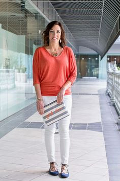 Spring Outfit: Orange Laila Jayde Bowie Dolman Sleeve Top via Stitch Fix, Stella & Dot All In One Good Vibes Pouch, white Paige Verdugo Ankle skinnies, Sam Edelman Flynt Ghillie Flats, gold monogram necklace (the 3XL size with a 16″ chain, white stone drop earrings and a stack of white and gold beaded bangles!
