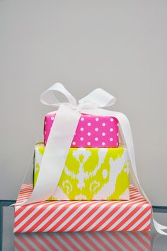 Neon Gift Wrap in hot pink polka dots, yellow ikat and orange stripes!