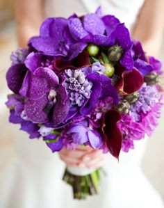 purple with a hint of red.....would be cool if the bride or bridesmaids arrangement was a lot of red with a hint purple....