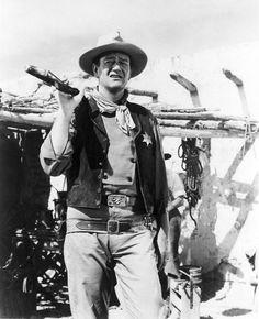 John Wayne wearing the Red River belt buckle
