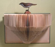 An old book is used to create a beautiful shelf.
