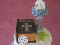 First Communion Cake with 40 Mini Cakes. VanillaBean Cake with Lemon Curd Filling, White Chocolate Ganache and covered in Fondant with Candied Pearls. The Bible is Rice Krispie Treats, The Cross and Chalice are made of Fondant. The wafers are actual Commu by FantasticalSweets, via Flickr