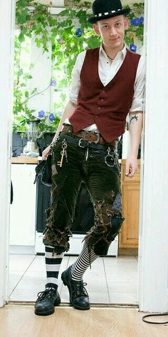 steampunk crossed with dieselpunk. waistcoat, button down shirt, bowler hat, knidkers ripped and patched, striped socks, keys and gears hanging from multiple belts
