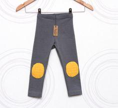Grey toddler leggings with yellow knee pads  by Zanda Baha