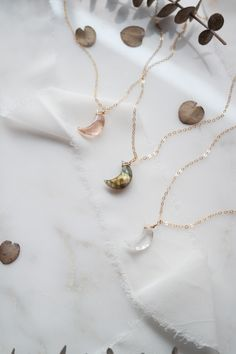 Beautiful Gemstone Moon Necklaces handcraved and handcrafted made with 14k gold filled dainty chain, available in Green flash labradorite, Crystal Quartz, Morganite Quartz All Handcrafted by The Modern Gem #goldjewellery #jewelry #gemstonejewelry #labradorite #Quartznecklace #handcrafted #daintyjewelry Moon Necklace, Quartz Necklace, Dainty Necklace, Dainty Jewelry, Cute Jewelry, Moon Jewelry, Gemstone Jewelry, Oct 11, Aromatherapy Jewelry