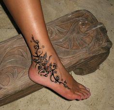 Gorgeous Flower Ankle Tattoo - http://www.gotattooideas.com/lovely-flower-ankle-tattoo/