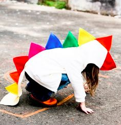 Kid's rainbow dino-hoodie. This is the coolest jacket for spring/ winter. Or even for dressing up for Halloween costume or imagination play.