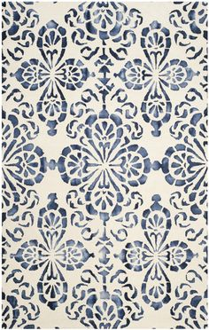 Features:  -Material: Hand tufted wool pile.  -Origin: India.  -Collection: Dip Dye.  Technique: -Hand woven/Tufted.  Primary Color: -Ivory/Navy.  Material: -Wool.  Product Type: -Area Rug.  Type of B