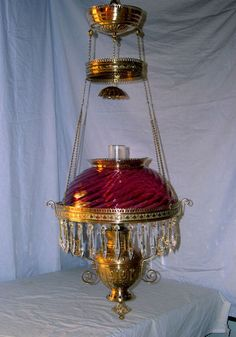 ANTIQUE ANSONIA HANGING OIL LAMP ( CRANBERRY SWIRL SHADE )