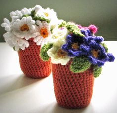 Flowerpots: Crochet pattern for Daisy and Primula / Primrose Flower pots (pdf). $3.50, via Etsy.
