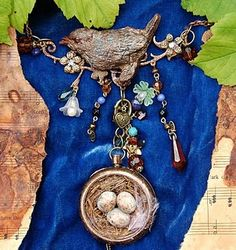 Altered pocket watch necklace with a cute bird theme -  made using  a sugar craft mould for the bird and hand rolled the eggs--made by Julie Dandy. Gorgeous!